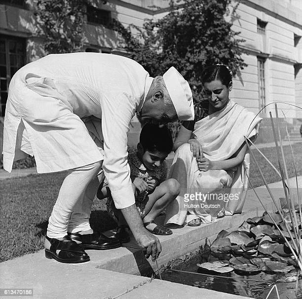 Indian statesman Nehru with his daughter Indria Gandhi and her son Rajiv
