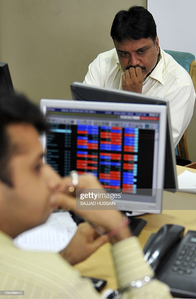 Indian stockbrokers react at a brokerage firm in Mumbai on May 25, 2010. Indian shares fell over three percent intraday, to a three-month-low of below 16,000 points level, as foreign funds sold riskier equities amid a deepening to Europe's debt woes.The benchmark 30-share Sensex index was down 509.4 points to a day's low of 15,960.15, half an hour prior to its close AFP PHOTO / Sajjad HUSSAIN