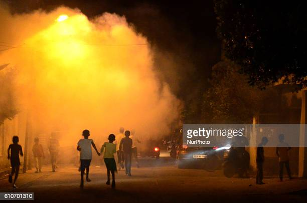 Indian street children play in smoke from fumigation in a busy old street of Allahabad on September 27201621 people died of dengue in last 3 weeks...
