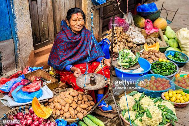 indian street seller in kathmandu - nepal stock pictures, royalty-free photos & images