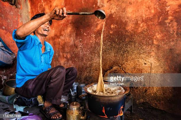 indian street seller selling tea - masala chai in jaipur - chai stock photos and pictures