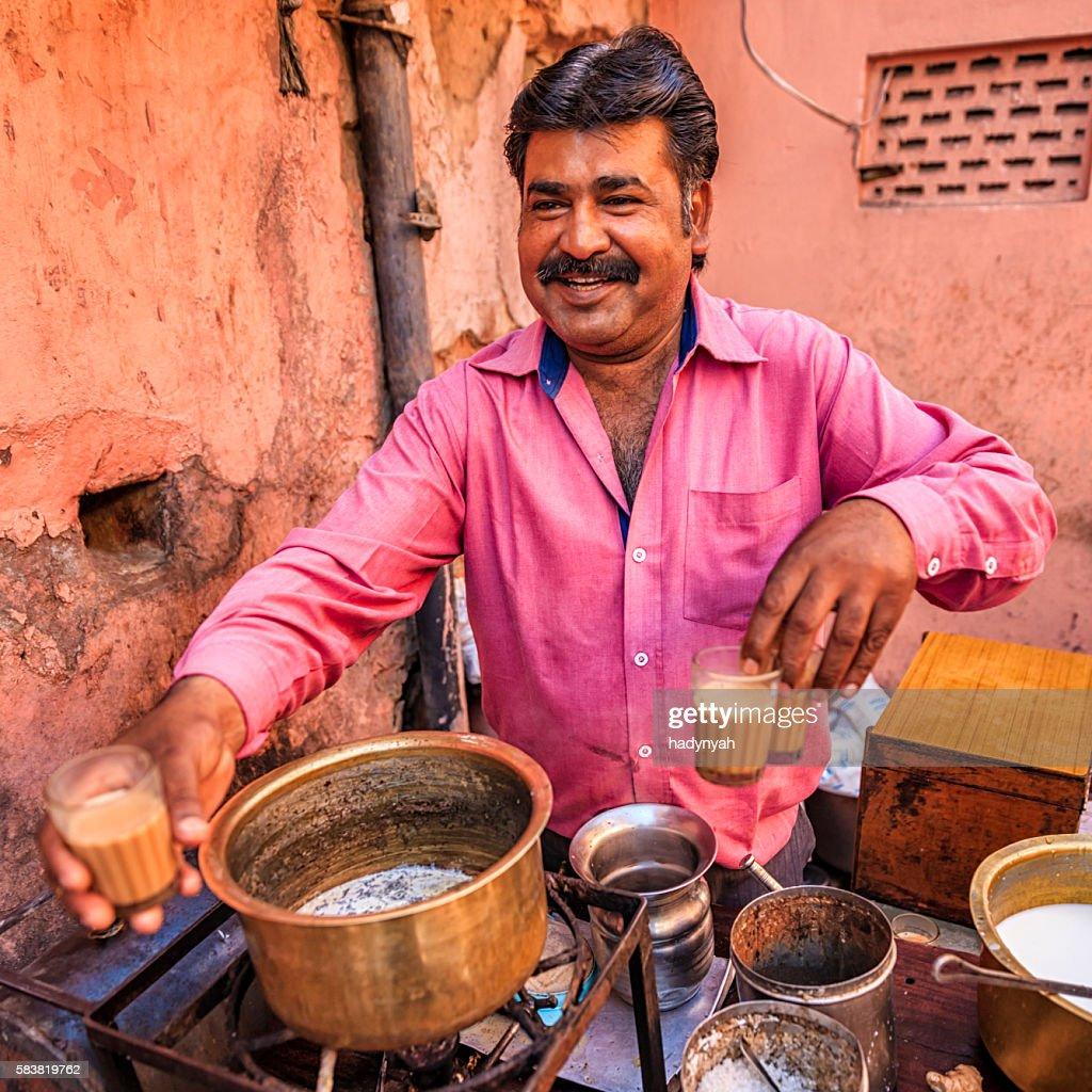 Indian street seller selling tea - masala chai in Jaipur : Stock Photo