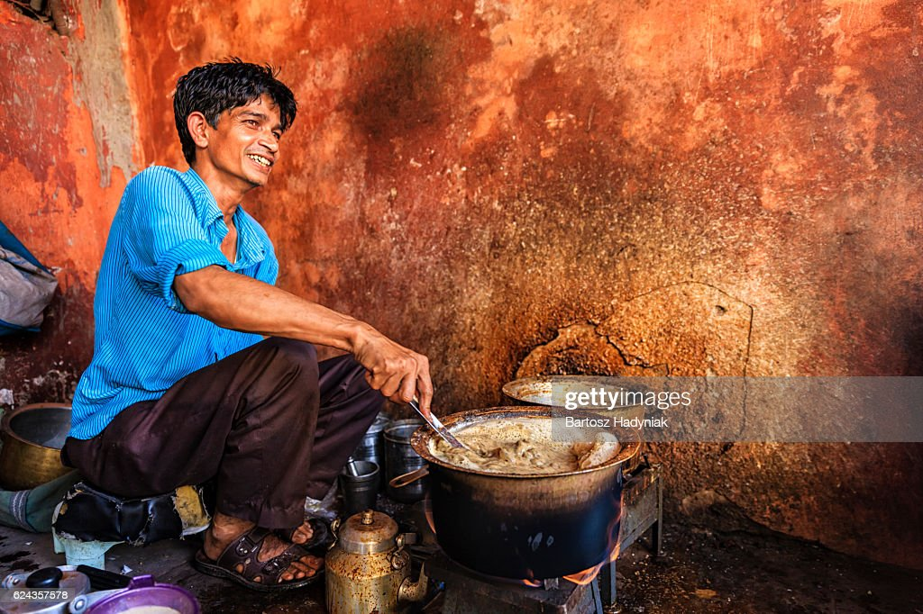 Indian street seller selling tea - masala chai in Jaipur : Stock Photo