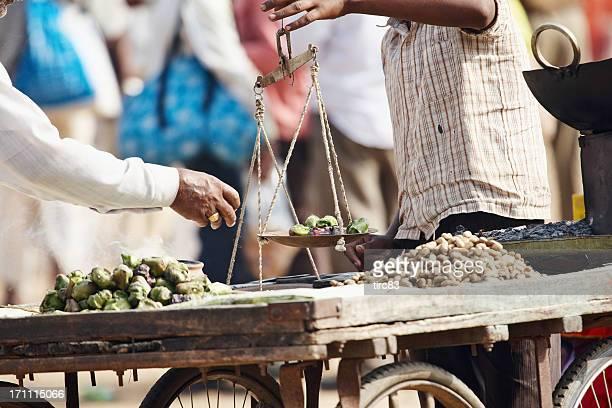 Indian street trader selling food snacks