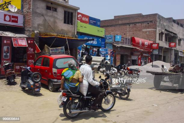 indian street traffic rush hour - emerging markets stock photos and pictures