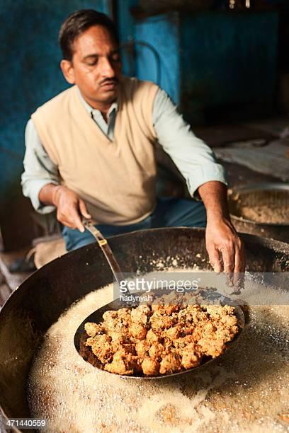 Indian street vendor preparing food