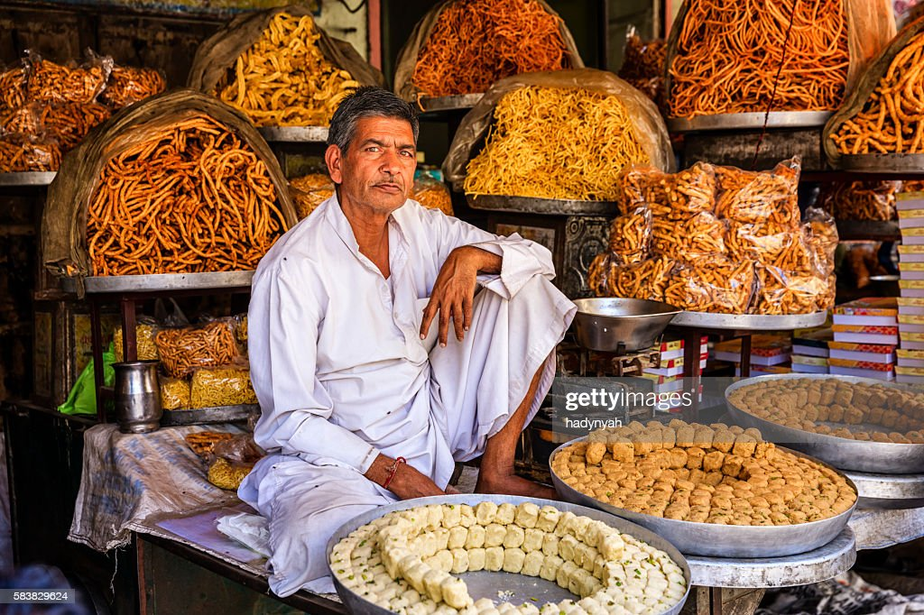 Indian street vendor selling sweets near Jaipur, India : Stock Photo