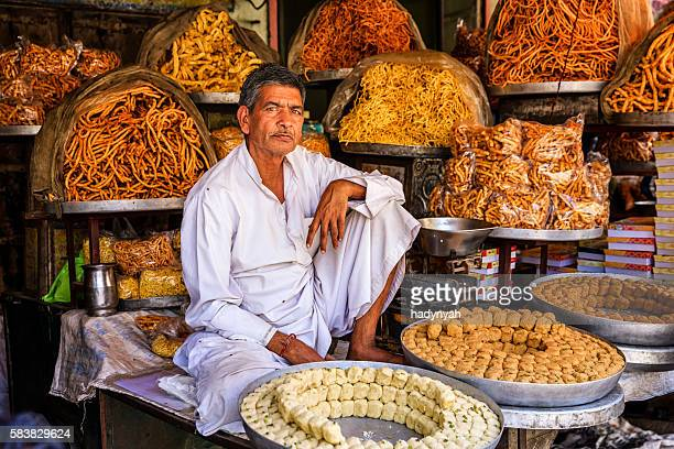 Indian street vendor selling sweets near Jaipur, India