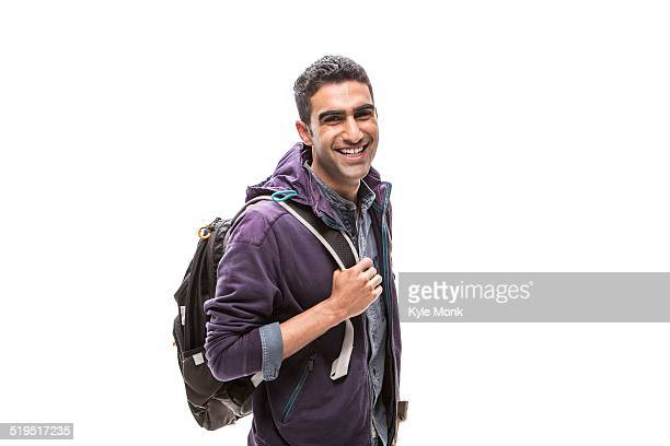 Indian student carrying backpack