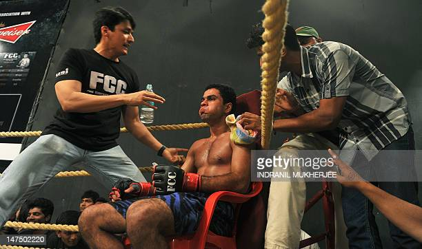 Indian student, judo practitioner and mixed martial arts fighter Aditya Despande is freshened up and given tips in-between rounds during his bout at...