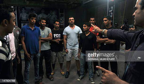Indian student, judo practitioner and mixed martial arts fighter Aditya Despande receives instructions along with fellow fighters before the start of...