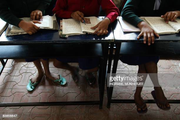 Indian students attend a class at Gokul the Manavya foundation residential school for HIV positive children in Bhoogaon some 175 kms Northeast of...