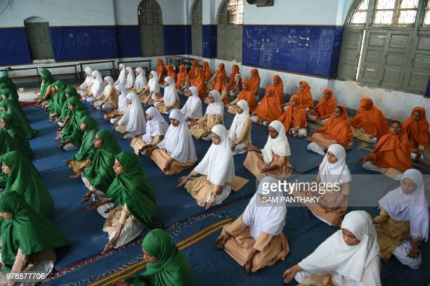 TOPSHOT Indian students from AnjumanEIslam school participate in a rehearsal yoga session ahead of International Yoga Day in Ahmedabad on June 19...