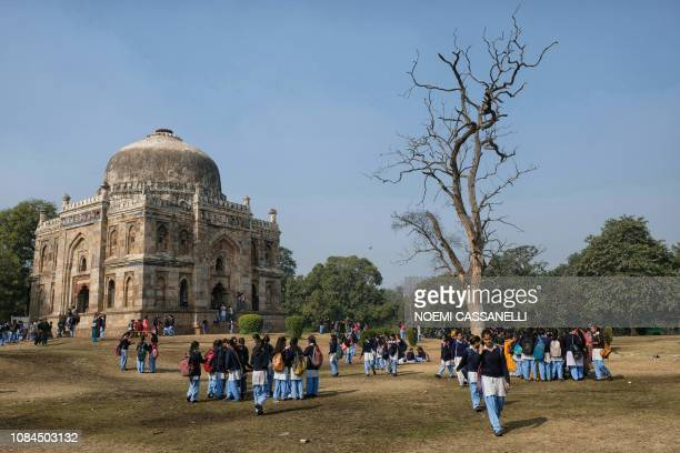 TOPSHOT Indian students from different grade classes visit Lodhi Gardens during a school tour in New Delhi on January 18 2019