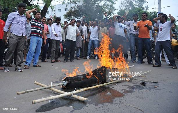 Indian students from Osmania University Joint Action Committe demanding a separate state of Telangana burn an effigy of Member of Parliament...