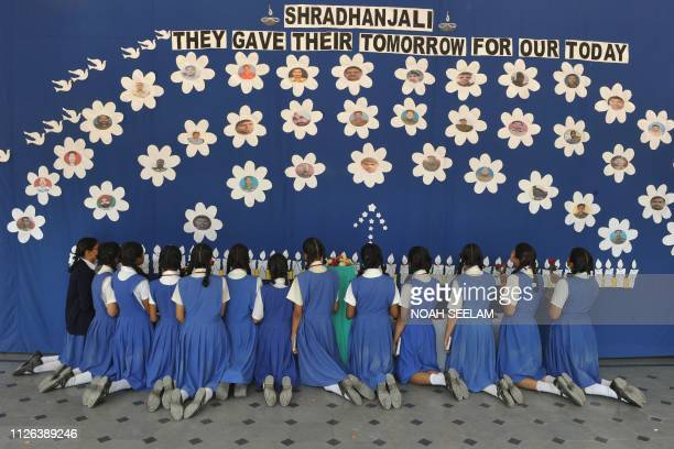 TOPSHOT Indian students from the Saint Francis Girls High School offer prayers as they pay tribute to the slain Central Reserve Police Force...