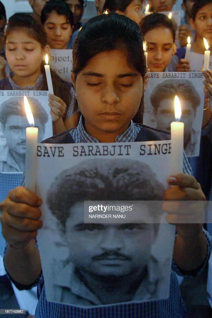 Indian students hold candles as they prayer for the good health of Indian death row prisoner Sarabjit Singh at a school in Amritsar on April 29, 2013. Sarabjit Singh is facing the death penalty in Pakistan on espionage charges and was rushed to hospital on April 26 after suffering serious injuries in a clash with fellow prisoners, officials said. Sarabjit was convicted for alleged involvement in a string of bomb attacks in Punjab province that killed 14 people in 1990.