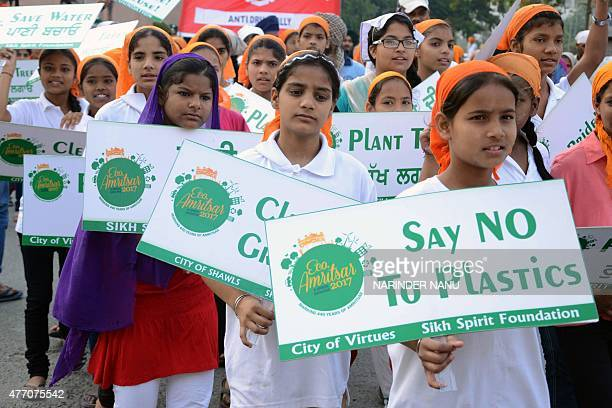 Indian students hold placards as they participate in an awareness march with the message of conserving the environment as they mark the 438th...