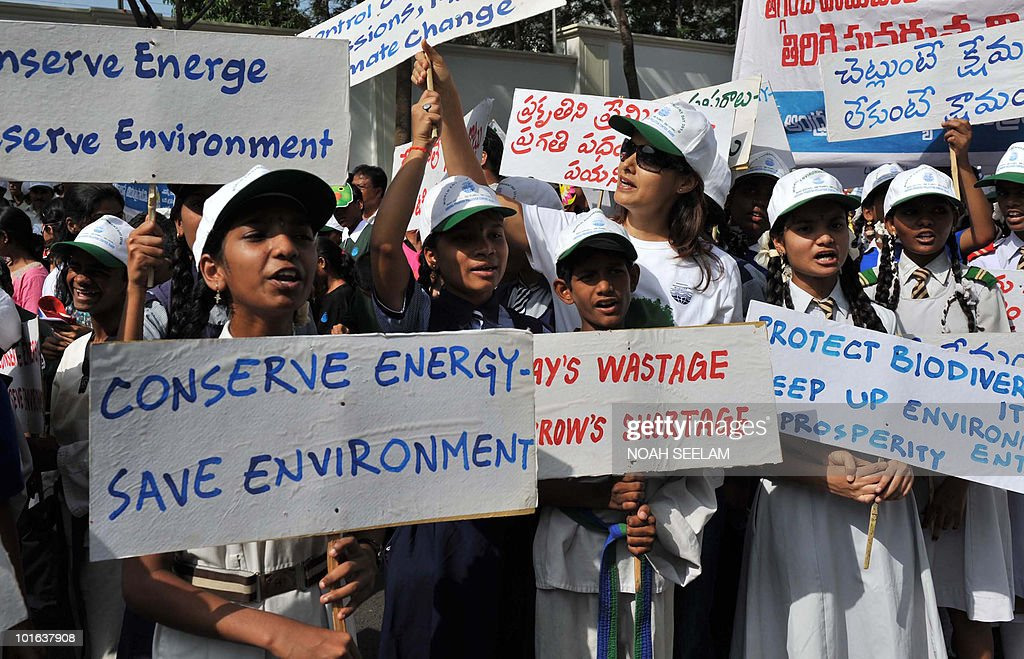 Indian students hold placards at a World Environment Day 'Green Rally' in Hyderabad on June 5, 2010. This year the theme of World Environment Day is 'Many Species. One Planet. One Future?'AFP PHOTO/Noah SEELAM