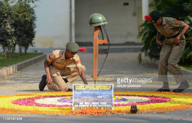 Indian students lay flowers on the ground to pay tribute to the Central Reserve Police Force troopers in Chennai on February 16 following an attack...