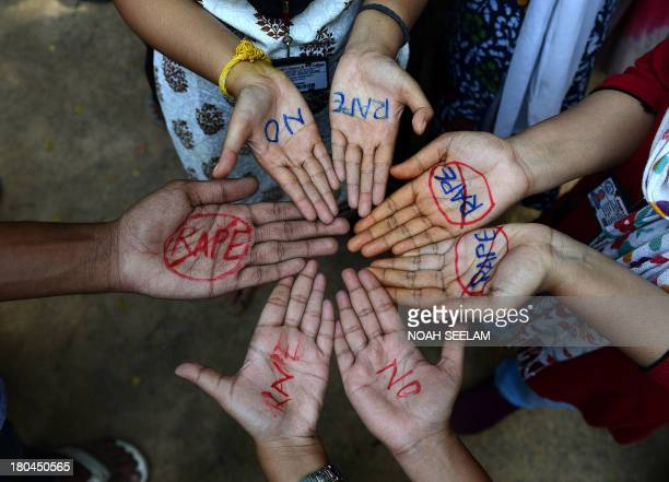 Indian students of Saint Joseph Degree college participate in an anti-rape protest in Hyderabad on September 13, 2013. The judge hearing the case of...