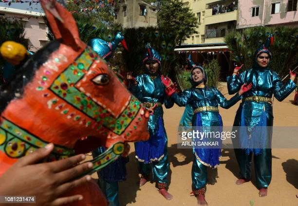 Indian students perform a peacock dance during celebrations for Pongal the Tamil harvest festival at a college in Chennai on January 12 2019
