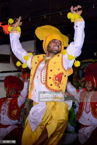 Indian students perform a traditional Punjabi 'Bhangra' dance during celebrations of a youth fetival competition at a university in Amritsar on...
