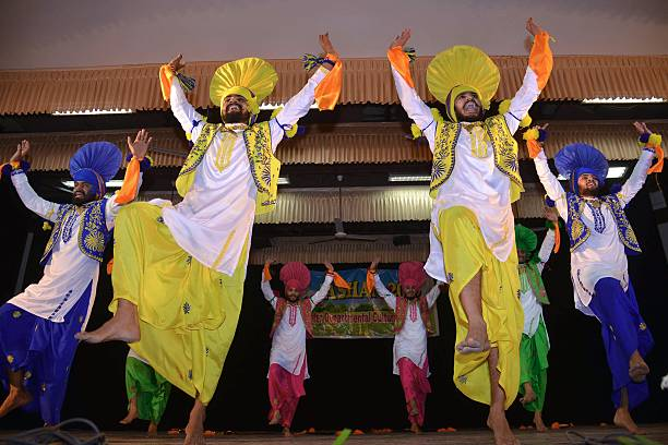 Indian students perform a traditional Punjabi `Bhangra` dance during celebrations of `Jashan 2015` Inter Departmental Cultural Program at a...