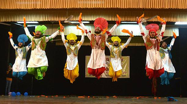 Indian students perform a traditional Punjabi `Bhangra` dance during celebrations of `Jashan 2016` Inter Departmental Cultural festival at a...