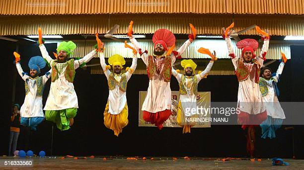 Indian students perform a traditional Punjabi 'Bhangra' dance during celebrations of 'Jashan 2016' Inter Departmental Cultural festival at a...