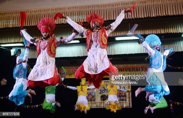 Indian students perform during bhangra dance competition at an university in Amritsar on March 9 2018 Bhangra is a traditional and lively form of...