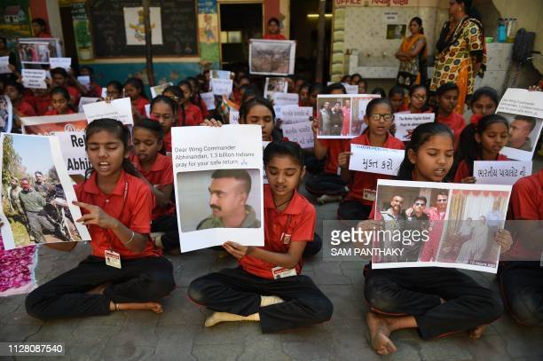TOPSHOT Indian students pray for a speedy release of Indian Air Force pilot Abhinandan Varthaman in a school in Ahmedabad on February 28 2019...