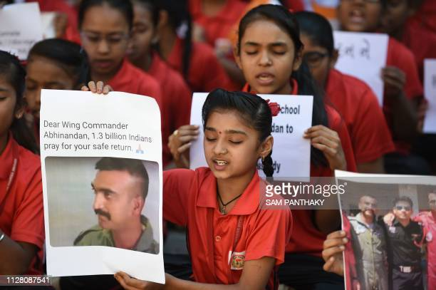 Indian students pray for a speedy release of Indian Air Force pilot Abhinandan Varthaman in a school in Ahmedabad on February 28 2019 Pakistan said...
