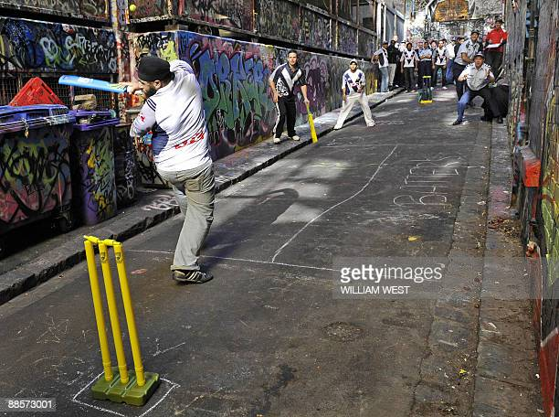 Indian students take on police officers in a game of laneway cricket in Melbourne on June 19 2009 to promote a message of harmony following a spate...
