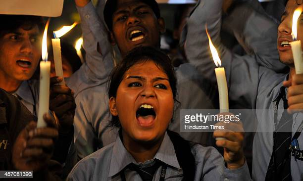 Indian students take part in a candlelight vigil at Jantar Mantar mark the first anniversary of Delhi gang rape on December 16 2013 in New Delhi...