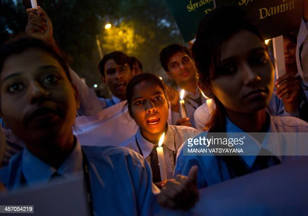 Indian students take part in a candlelight vigil commemorating the December 2012 fatal gangrape of an Indian woman in New Delhi on December 16 2013...