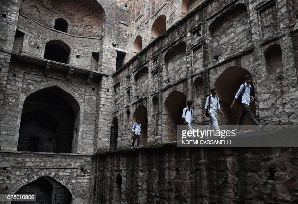 Indian students visit Agrasen ki Baoli stepwell in New Delhi on August 29 2018