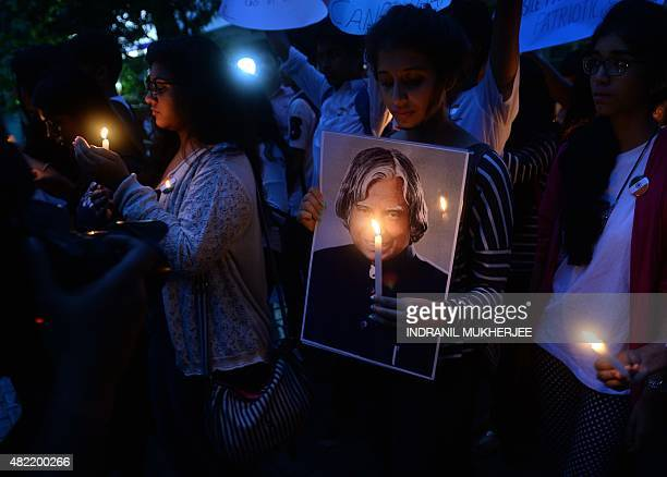Indian students walk during a candle light vigil in memory of India's former president and top scientist A P J Abdul Kalam in Mumbai on July 28 2015...