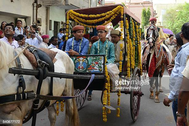 Indian students wearing traditional dress participate in a procession during the traditional School Induction Ceremony of Gurukulam Hemchandracharya...