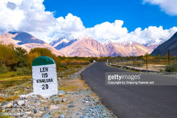 Indian style milestone beside the road to Nubra valley, Ladakh, India.
