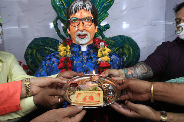 Indian Super star Actor Amitabh Bachchan Fans Club Members performs a prayer in front of a star Actor Amitabh Bachchan Idol to celebrate his 78th...