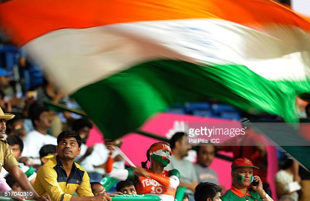 A Indian supporter waves the national flag during the ICC World Twenty20 India 2016 match between India and Bangladesh at the Chinnaswamy stadium on...