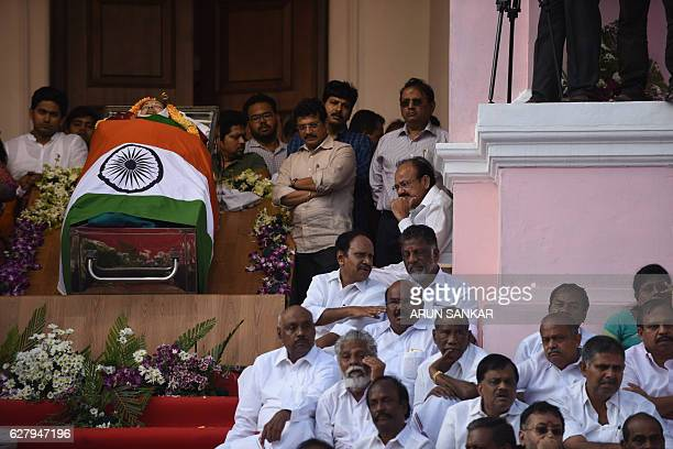 Indian supporters and ministers gather alongside the coffin of Tamil Nadu Chief Minister Jayalalithaa Jayaram at Rajaji Hall in Chennai on December 6...