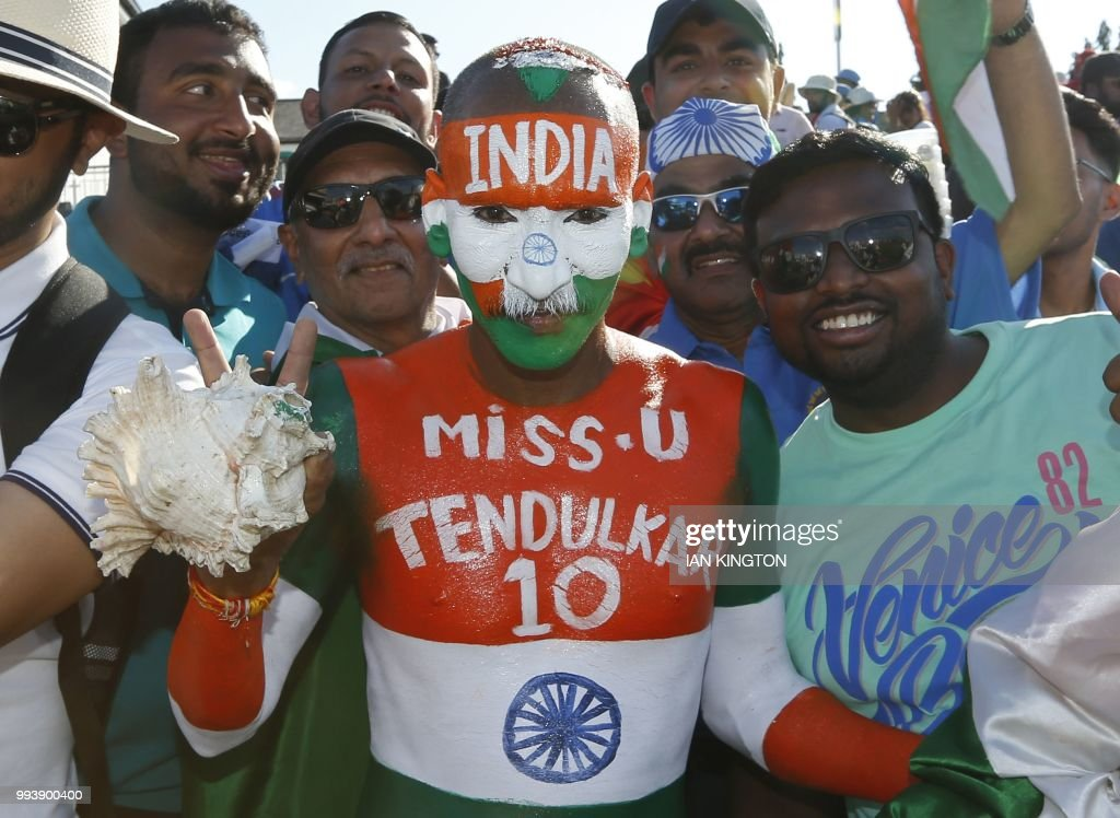 TOPSHOT - Indian supporters celebrate after the third international Twenty20 cricket match between England and India at The Brightside Ground, Bristol on July 8, 2018. - India won by 7 wickets after England batted first and threatened to post a huge score before stuttering at the end and finishing on 198-9 after their 20 overs. (Photo by Ian KINGTON / AFP) / RESTRICTED