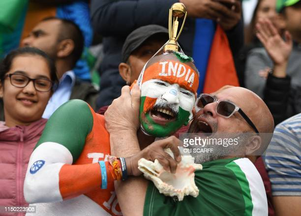 Indian supporters celebrate in the crowd during the 2019 Cricket World Cup group stage match between India and Pakistan at Old Trafford in Manchester...