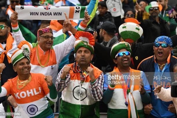 Indian supporters celebrate in the crowd during the 2019 Cricket World Cup group stage match between India and Pakistan at Old Trafford in...