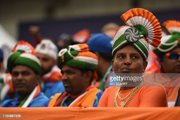 Indian supporters dressed in the national colours look on during the 2019 Cricket World Cup first semi-final between India and New Zealand at Old...
