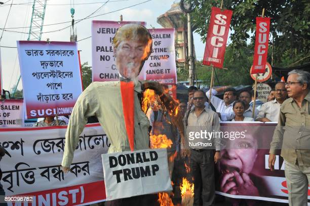 Indian Supporters for The Socialist Unity Centre of India Communist,SUCI burn effigy US president Donald Trump and protest against US-Israeal Thugs...