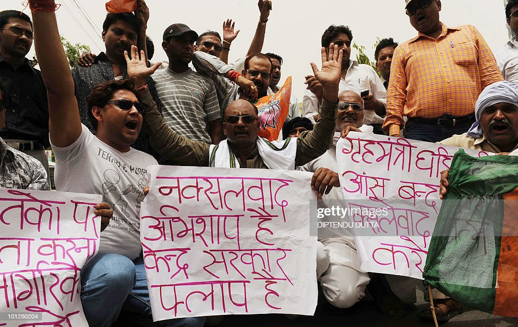 Indian supporters from the Bharatiya Janata party chant anti-governmennt slogans during a protest in Allahabad on May 29, 2010, accusing the government of failing to stop the maoist attack in Chattisgarh and West Bengal. Indian rescue workers recovered more bodies in their gruesome search for victims of a train wreck blamed on Maoist saboteurs, with fears that the final death toll could exceed 150. AFP PHOTO/Diptendu DUTTA