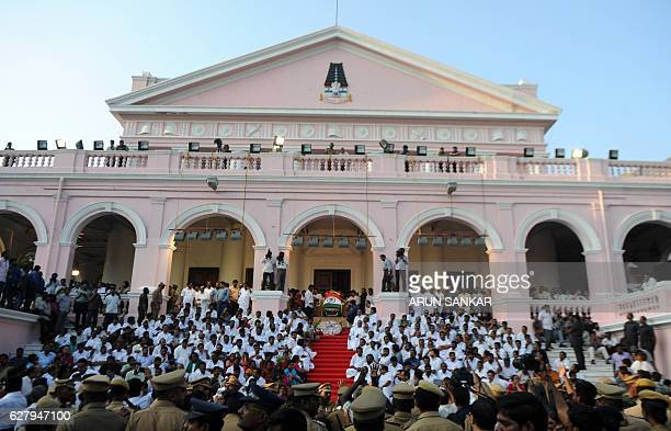 Indian supporters gather at Rajaji hall where the body of Tamil Nadu Chief Minister Jayalalithaa Jayaram is lying in state in Chennai on December 6...
